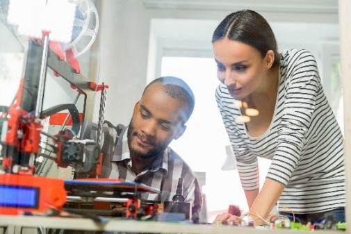 man and woman working on developing a mechanical prototype