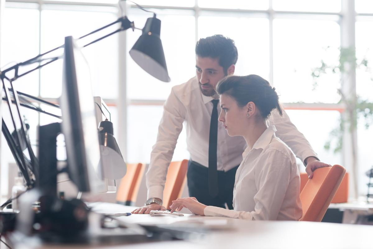 Two people working together in an office